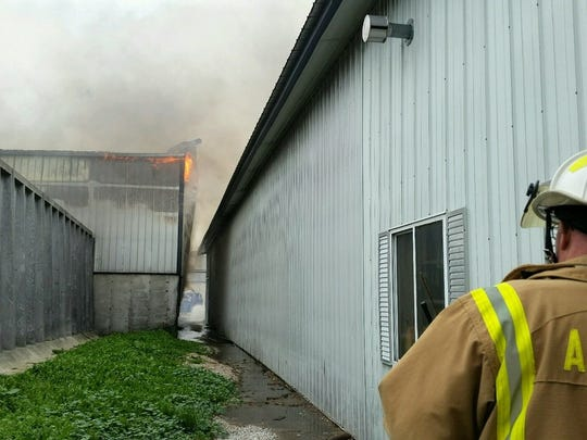 Firefighters from as far north as Sturgeon Bay and as far south as Mishicot responded to a hay shed fire at Ebert Enterprises on Thursday.