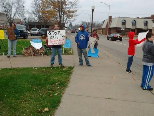 Protesters opposing the Dakota Access Pipeline hold