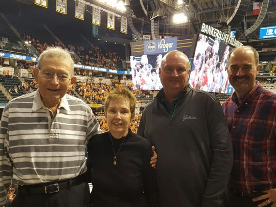 Bill May (left) with wife Carolyn and sons John (second from right) and Paul.