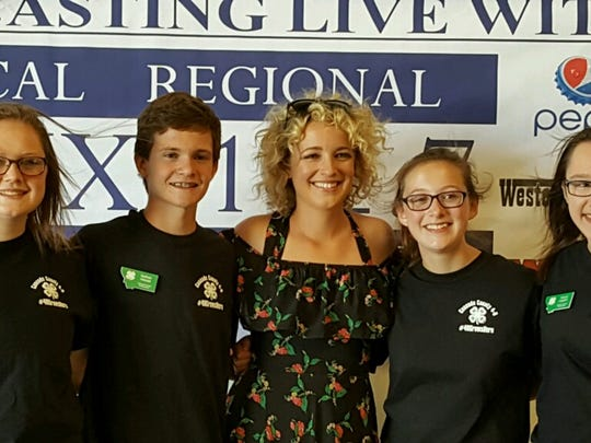 From left, Jessica Banks, Nathan Hessel, Taylor Bogden and Abigail Leggett, all teens in the 4-H program, got to meet country star Cam (center) at last year's Montana State Fair.