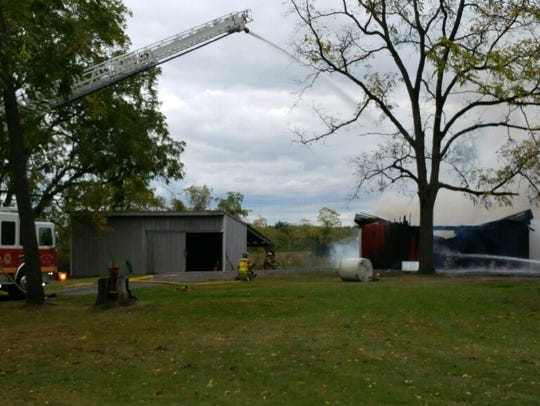 Firefighters work to put out a structure fire Thursday