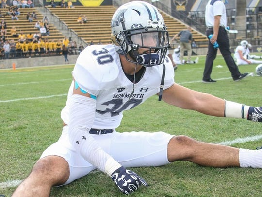 Monmouth's All-American safety Mike Basile, who played at Brick Memorial, stretches prior to last Saturday's game against Kennesaw State.