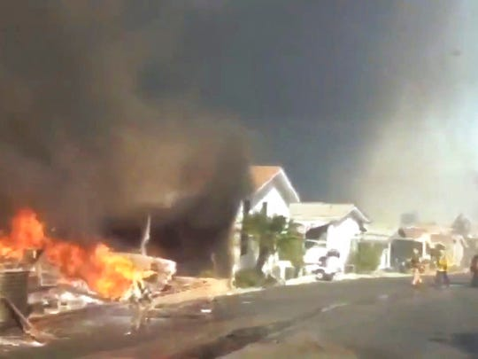 In this video grabbed image released by the San Diego Fire Department Strike Team @SDFD shows a row of homes burning in the Lilac fire in Bonsall, Calif.