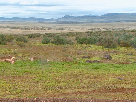 This April 15, 2017, file video image courtesy of KTVB-TV shows the remote area where skeletal remains were found in a badger hole north of Mountain Home, Idaho. The U.S. government says it's working with two Native American tribes to return the 500-year-old, well-preserved bones of a young adult and child found in a southwestern Idaho badger hole to one of the tribes.