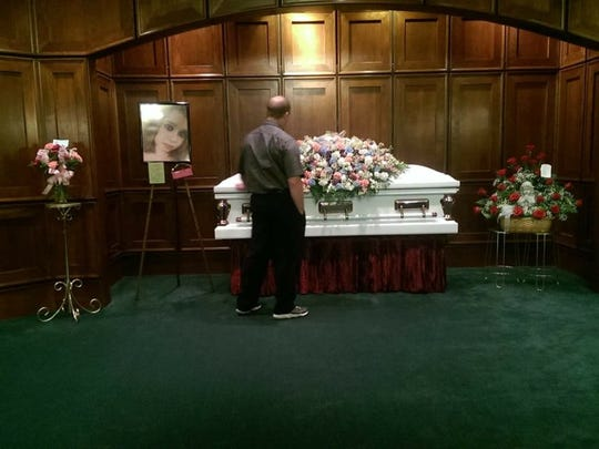 Chris Stansberry looks at the casket holding the body of his daughter, Tierra Stansberry.
