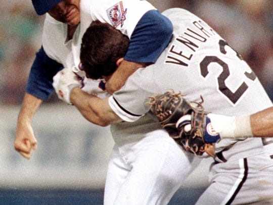 FILE -- Texas Rangers pitcher Nolan Ryan, left, hits