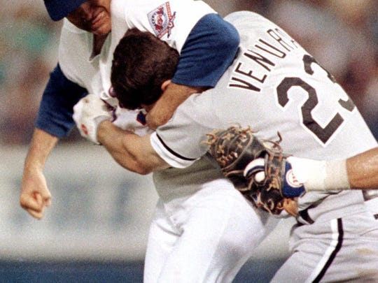 FILE -- Texas Rangers pitcher Nolan Ryan, left, hits Robin Ventura of the Chicago White Sox after Ventura charged the mound in Arlington, Texas, in this Aug. 4, 1993 photo.