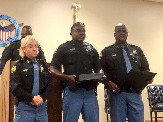 Hattiesburg police officer David Wynn II, center, was
