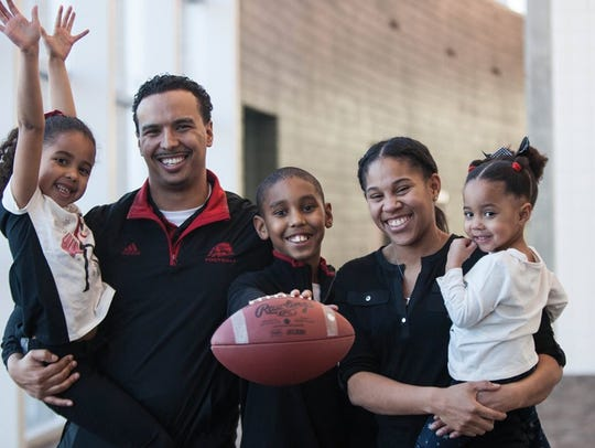 SUU head football coach Demario Warren poses with his