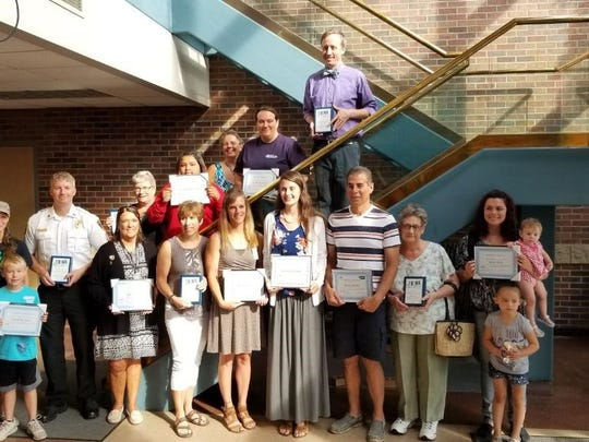 Community members were recognized for tobacco prevention efforts July 12. Pictured, back row, from left: Steele Beeman and Shannon Beeman accepting award for Chad Beeman, Dave Murack, Donna Eiles, Arianna Bustamante, Amber Daugs and Alan Duvall.  (Coordinator Cath Tease is in the photo, but not an awardee); front row, from left: Juli Novak, Candy Ruffolo, Becky Rice, Brooke Behrendt, Bruce Jacobs, Judy Tadych and Sarah Suth. Not pictured: Elizabeth Harris, Ellie Engelbrecht, Pauline Haelfrisch and Chad Beeman.