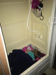 With seven people and three dogs in one camper, beds fill up fast. As the youngest and smallest in the family, 1-year-old Marie Guidry spent her nights in the bathtub/shower filled with pillows.