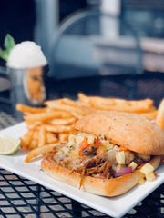 Old Capital Tavern's Islander Pulled Pork Sandwich is one of many feature dishes to creatively incorporate their house-smoked pulled pork.