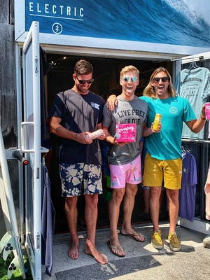 Kyle  Cook, center, said his extended family has annual Rye Beach reunions, including with his cousins Tyler, left, and Ryan McGill, who own Summer Sessions Surf Shop in Rye. [Courtesy photo].