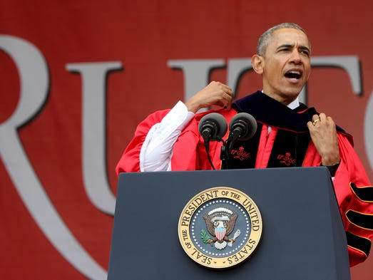 President Barack Obama adjusts his Honorary Doctor
