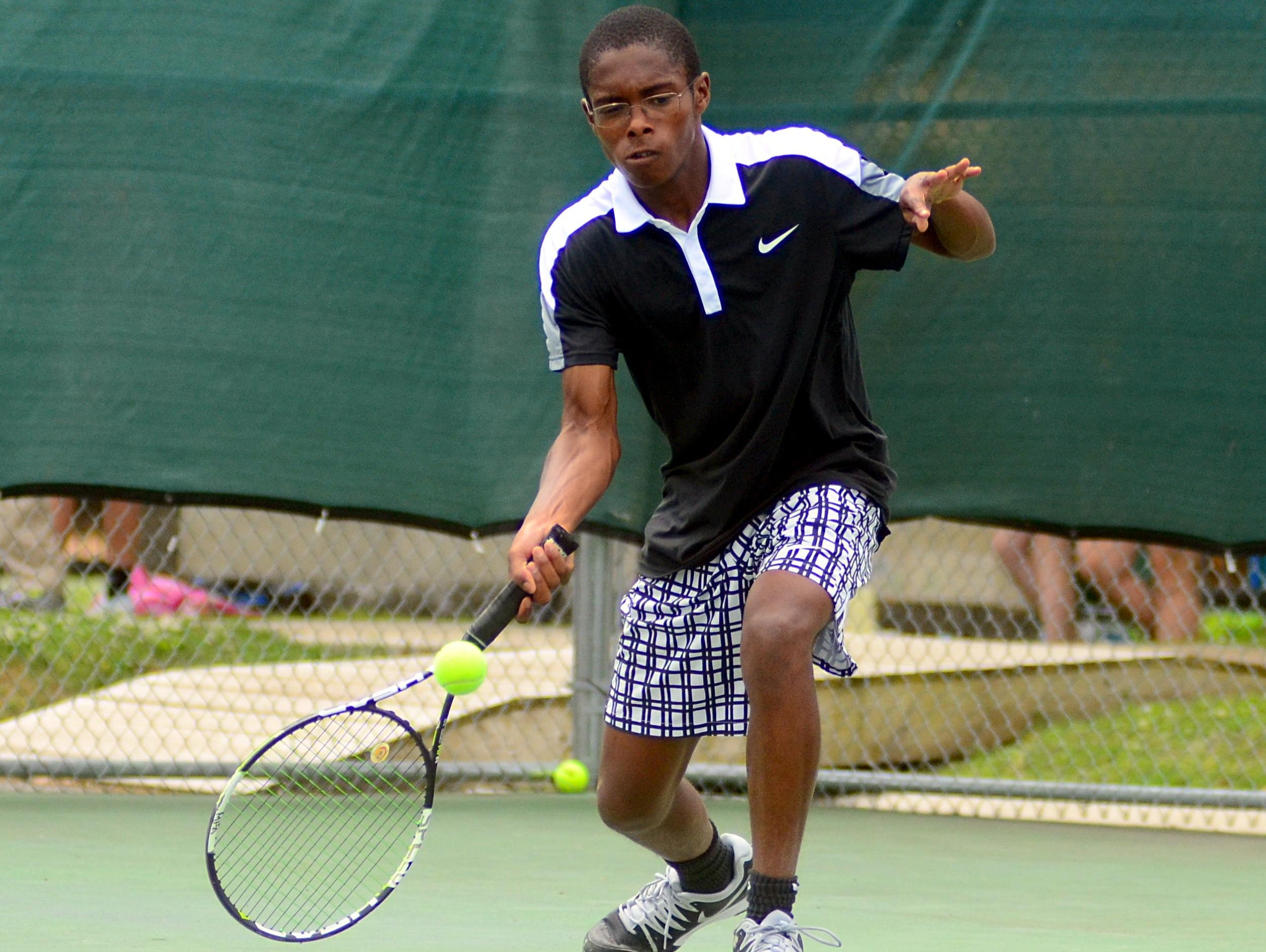 Hendersonville High senior Kato Richardson hits a forehand during his first-round singles match on Tuesday at the District 9-AAA Individual Tennis Tournament. Richardson won his third consecutive district singles title on Wednesday.