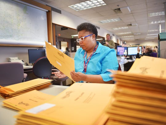 Denise Tucker mails out absentee ballots during early voting at the Minnehaha County Courthouse Tuesday, April 24, in Sioux Falls.