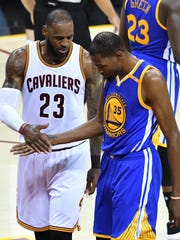 Kevin Durant #35 of the Golden State Warriors and LeBron James #23 of the Cleveland Cavaliers exchange words during Game 4 of the 2017 NBA Finals.