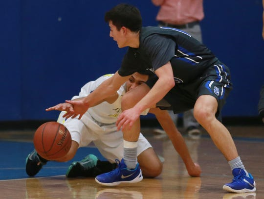 Former Americas' Tristen Licon, right, and Eastwood's Daniel Vargas scramble to control a loose ball during a game last year.