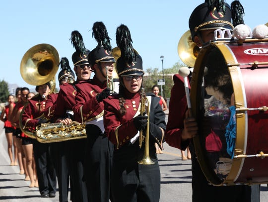 Gasden band members play a song as they march at the