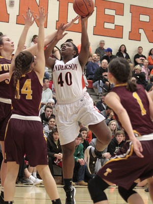 DaLisa McCallum of Anderson puts up a hook shot against Turpin.