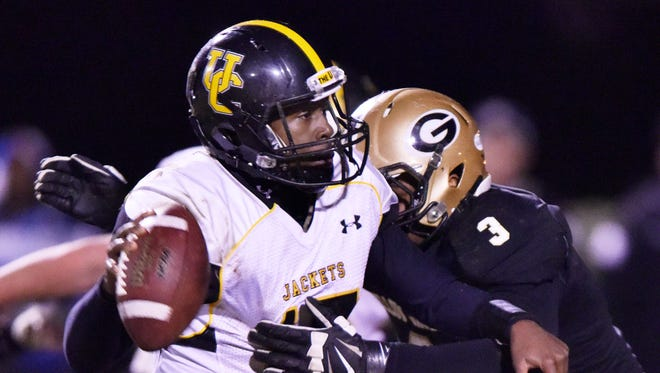 Greer's Quantavious Cohen (3) sacks Union County quarterback De'airrius Smith (17).