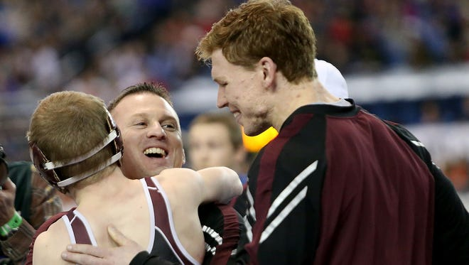 South Kitsap wrestling coach (center) led the Wolves to a Class 4A state title in February. Nass is the Kitsap Sun's Coach of the Year in 2018.