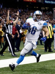 Detroit Lions fullback Michael Burton (46) caries on a touchdown reception in the first half of an NFL football game against the New Orleans Saints in New Orleans on Monday, December 21, 2015.