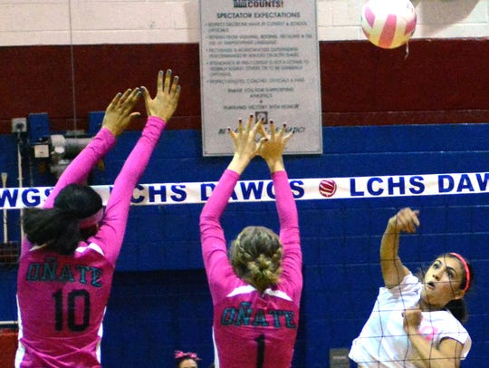 Las Cruces High's Alyssa Barrera goes up for a kill