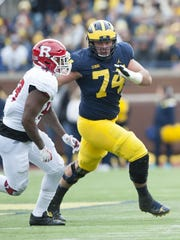 Changes on the offensive line might dictate Ben Bredeson
