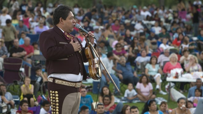 Valentin del Castillo of Mariachi Los Toritos sings during a performance at the Music Under the Stars summer concert series at the Chamizal National Memorial.