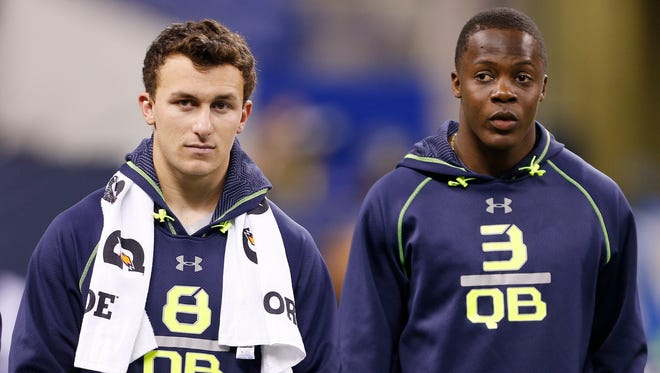 Texas A&M quarterback Johnny Manziel, left, and Louisville Cardinals quarterback Teddy Bridgewater take in the action at 2014 NFL Combine at Lucas Oil Stadium in Indianapolis on Feb. 23, 2014.
