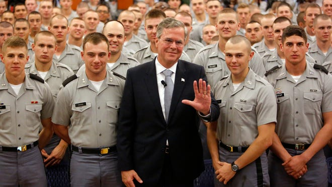 Republican presidential candidate Jeb Bush poses with Citadel cadets after giving a speech on foreign policy on Nov. 18, 2015,