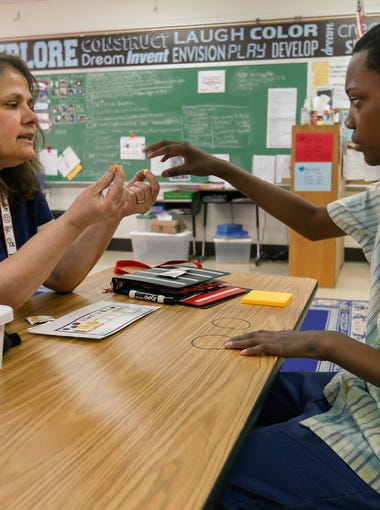 Jean Lawson, who was recently named Springfield's Teacher of the Year for 2018-19, works with Nathaniel Chester in her class at Truman Elementary School on Monday, April 23, 2018.