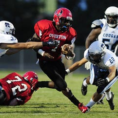 Centennial players Trent McDemott (37) and Peyton Pisacane (22) try to catch Overton's Ugo Amadi (7) during a game at Overton on Aug. 29, 2014. Amadi is a true freshman at cornerback for the Ducks this spring and is drawing praise from teammates.
