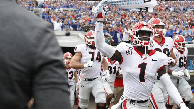 Georgia defensive back Divaad Wilson (1) and his teammates take the field before the start of a NCAA football game between Georgia and Florida in Jacksonville, Fla., on Saturday, Nov. 2, 2019.