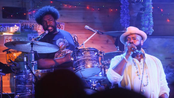 The Roots' Questlove, left, and Black Thought perform