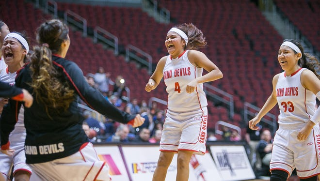 Page's Natasha Henry (4) and Ashley Dempsey celebrate winning their girls Division III high school basketball semifinals game against Winslow at Gila River Arena in Glendale on Friday, February 27, 2015.