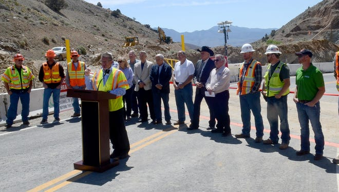 Thor Dyson, district engineer for the Nevada Department of Transportation, speaks at a ribbon cutting ceremony Tuesday in Golden Hill marking the reopening of the State Route 342. The roadway was closed for nearly four months.
