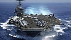The Nimitz-class aircraft carrier USS Carl Vinson will