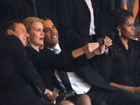 President Obama and British Prime Minister David Cameron pose for a selfie picture with Danish Prime Minister Helle Thorning Schmidt.