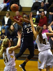 Lebanon Catholic's Alexis Hill fires a pass between