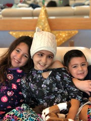 Brie, pictured in the middle, gets a little sibling support while hospitalized.