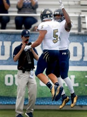 FIU's Thomas Owens (81) celebrates his touchdown with Julian Williams (5) in the fourth quarter of the game against MTSU, on Saturday, Oct. 7, 2017, at MTSU.