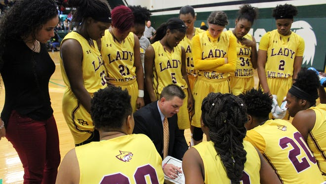 PRCC women's head basketball coach Scotty Fletcher draws up a play during a time out in a recent MACJC game at Meridian.