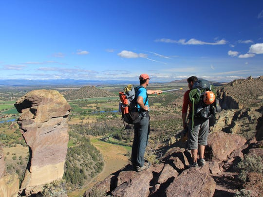 Salem residents Vincent Dunn, left, a leader with the Chemeketans outdoors group, and Curtis Horner, check out the area they plan to climb at Smith Rock State Park
