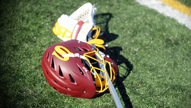 Salisbury lacrosse gear lays on the turf on Saturday, March 11, 2017 at Roy Kirby Jr. Stadium in Chestertown.
