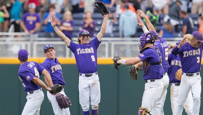 LSU celebrates defeating Oregon State during an NCAA College World Series baseball game Friday, June 23, 2017, in Omaha, Neb.