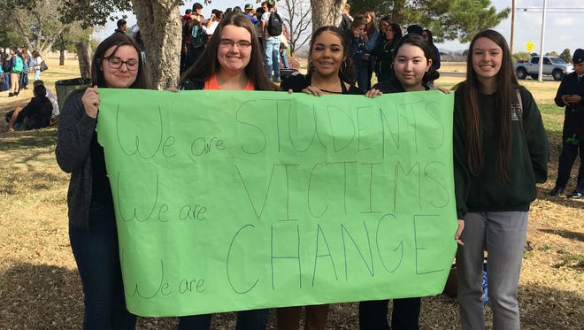 Students at Mayfield High School in Las Cruces stage a walk-out protest against gun violence on Wednesday, March 14, 2018, one month after 17 students were killed in a shooting a high school in Florida
