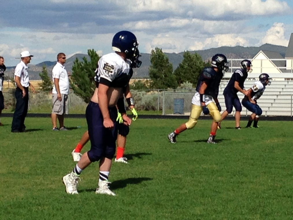Enterprise Wolves adapt no-huddle spread formation after years of running Wing T offense.