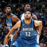 Minnesota Timberwolves center Karl-Anthony Towns (32) drives against Los Angeles Lakers forward Larry Nance Jr.
